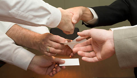 A group of people with a business card exchange.